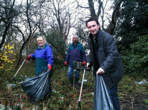 Bernie Ryan, Cllr Norman Lewis and John Leech MP helping clear Southern Cemetery