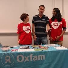 John with Oxfam workers raising funds to help refugees affected by the conflict
