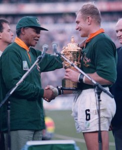 President Mandela presenting the 1995 World Rugby Cup to South African captain Francois Pienaar