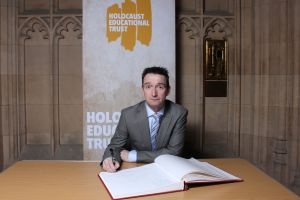 John signing the Holocaust Memorial Book of Commitment in Parliament this week