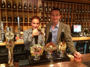 Lily showing John how to pull a pint at Robinsons Brewery in Stockport